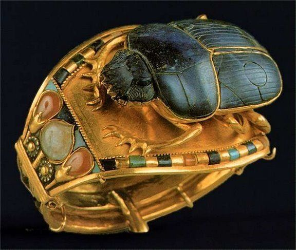 Scarab Bracelet Excavated from the Tomb of King Tutankhamun -- Circa 1323 BCE -- Gold, lapis lazuli, turquoise, cornelian & quartz -- Image from a Tutankhamen Exhibition: The small circumference of this bracelet suggests that it was made for Tutankhamun when he was a child. Belonging to the Museum of Egyptian Antiquities, Cairo.