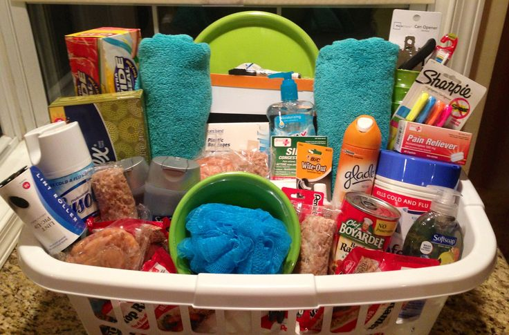 "An ""Off to College"" Basket I put together for my step sisters high school graduation. Cleaning Supplies, First Aid, Plates, Cups, Towels, Snacks and Hygiene Products."