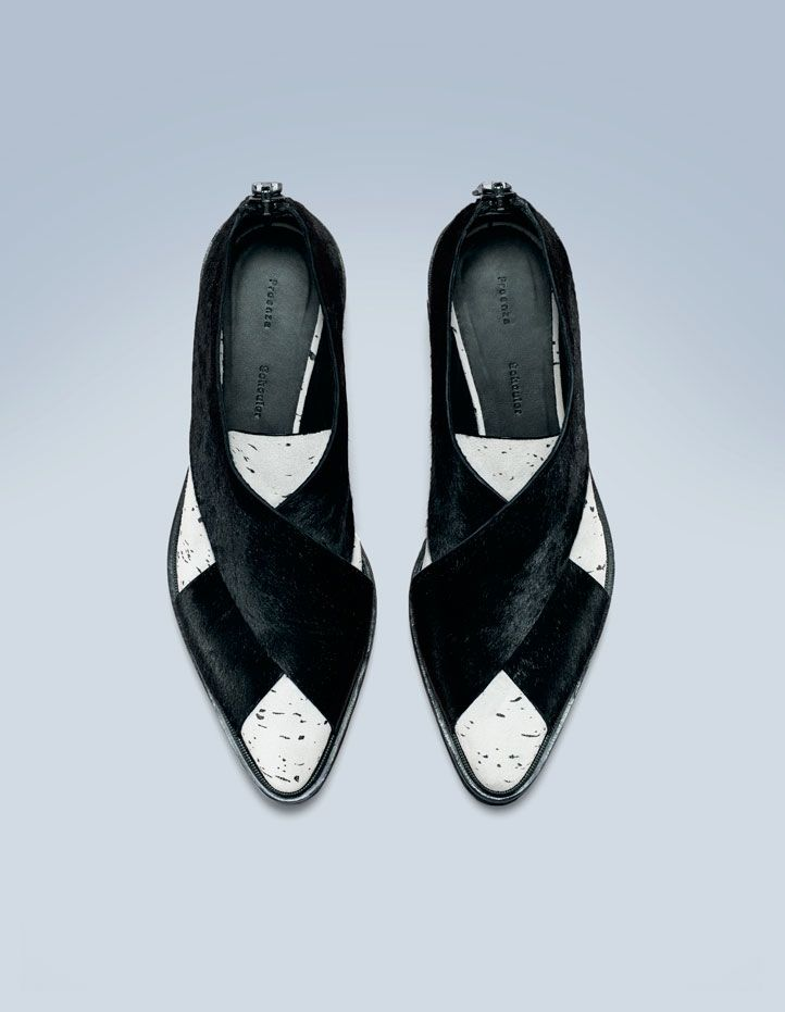 Black/white pony and speckled leather flat