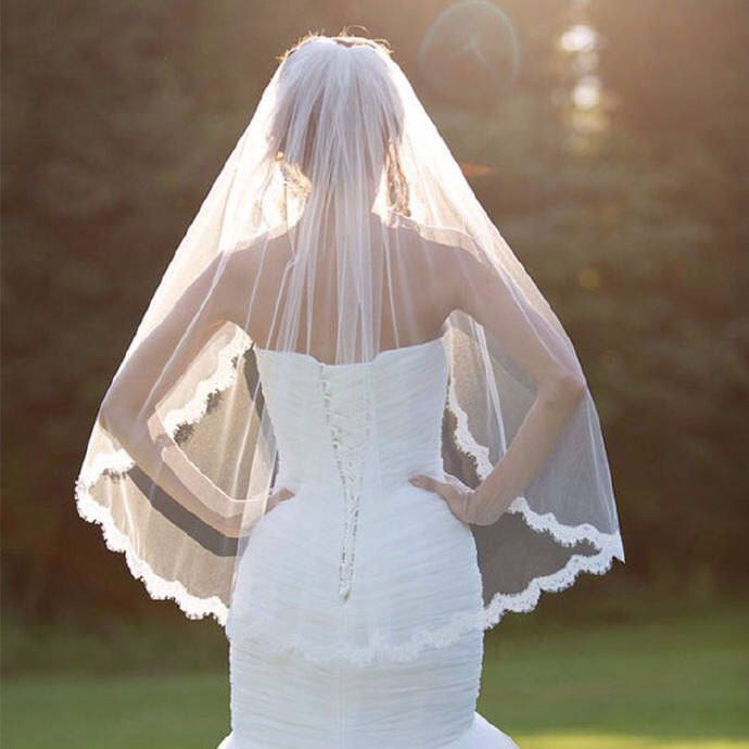 White or Ivory Wedding / First Communion Veil One-tier Fingertip Veils Lace Edge With Comb by angelinayamazaki on Etsy https://www.etsy.com/listing/512534143/white-or-ivory-wedding-first-communion