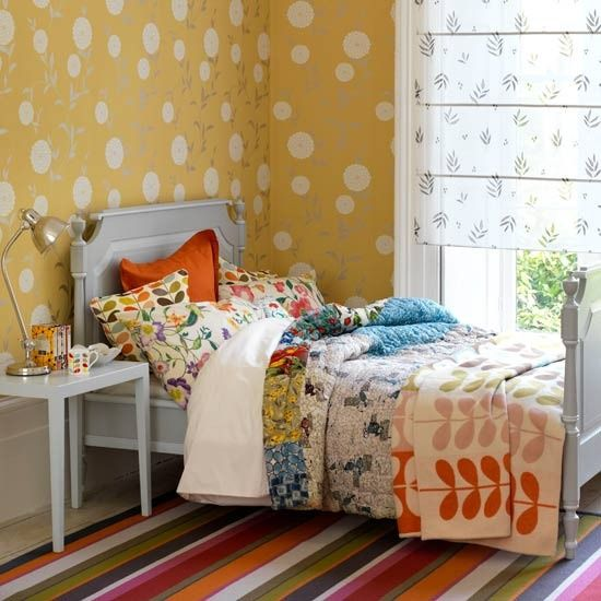 Country cool layered bed linen with a retro twist  Teenage girls aren't all fans of obviously 'girly' schemes – a muted palette of neutral nature-inspired patterns, layered with a brightly striped rug and cool grey furniture, looks chic and still has a feminine feel.