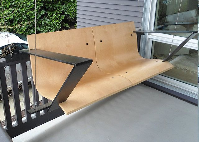 a modern take on the traditional porch swing with bent plywood seats and steel frame