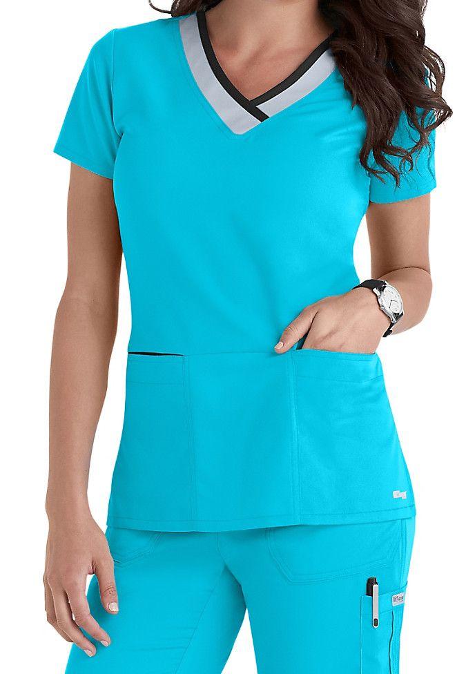 Greys Anatomy color block contrast 3 pocket scrubs top. Main Image
