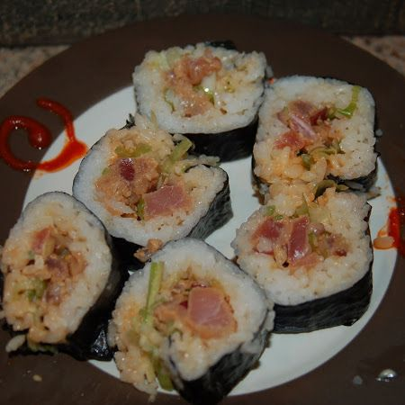 Spicy Tuna Roll Recipe   Ingredients 1 tsp Sriracha 2 tbs Japanese mayo ½ tsp mirin 2 tbs finely chopped green onions 1 tsp lemon zest 3 oz poki, diced Pickled ginger for serving wasabi for serving ponzu sauce for serving