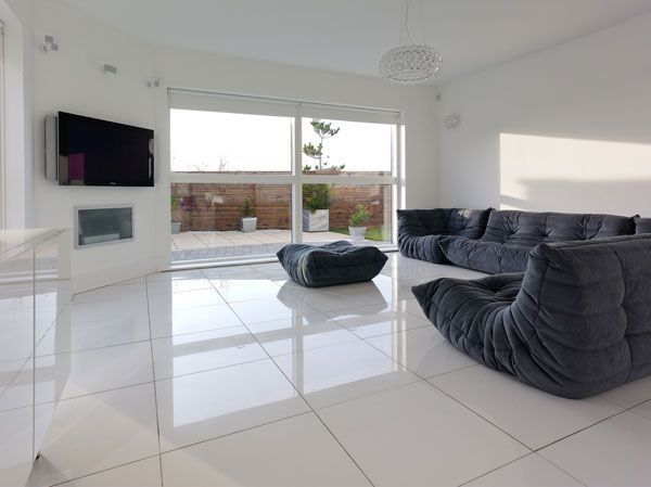 Living Room, Spacious Open Living Room With Intriguing Black Sofa Amusing TV Panel Wonderful Pendant Lamp Interesting Coffee Table Stunning ...