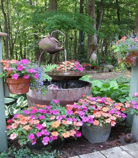 Add a piece of DIY decor to your garden or backyard with this fountain made from an iron tea pot and an old whiskey barrel.