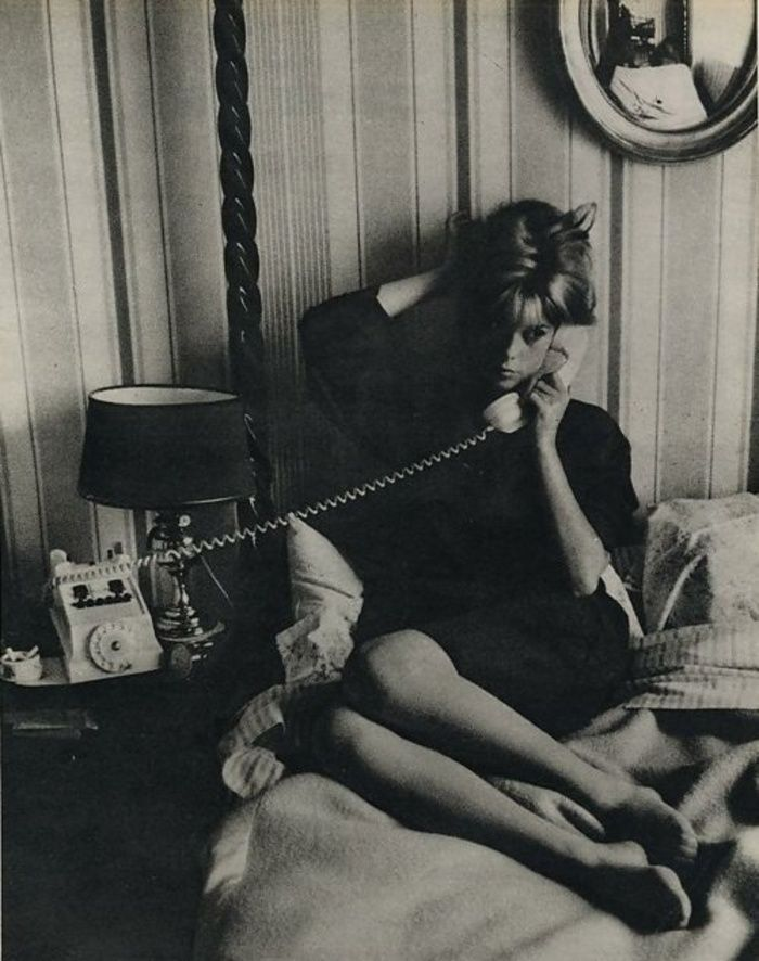 0 catherine deneuve on the phone on a bed