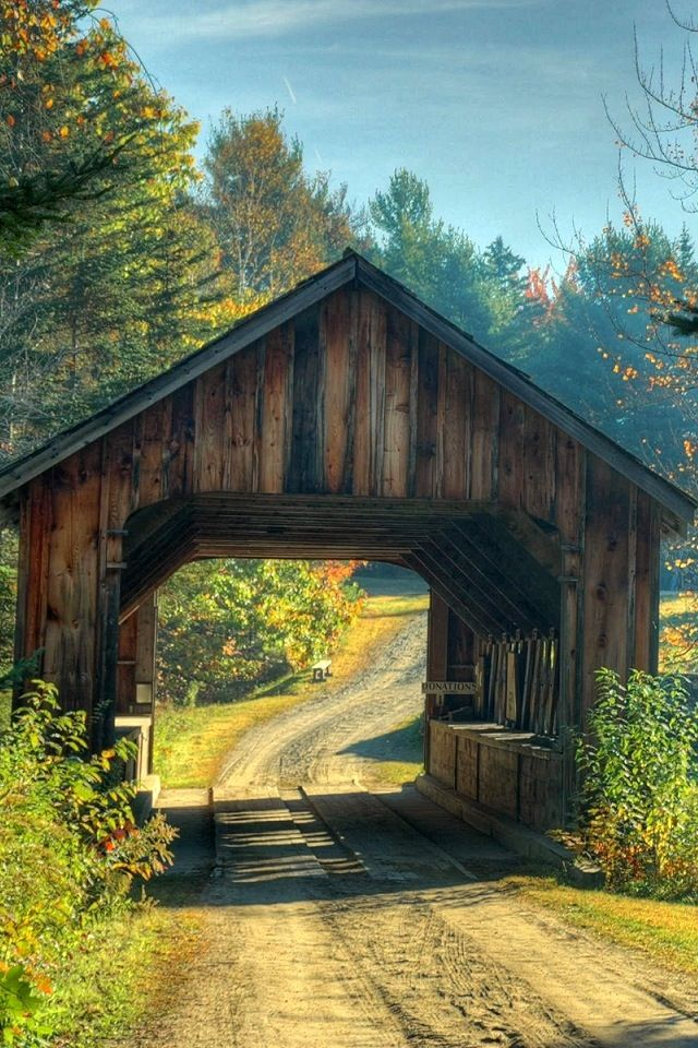 covered bridge on an old country road. I could live here its so peaceful... ahh :)