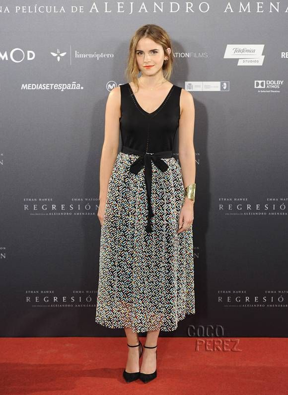 Emma Watson( in Black and White) attends Regression premiere in Madrid.