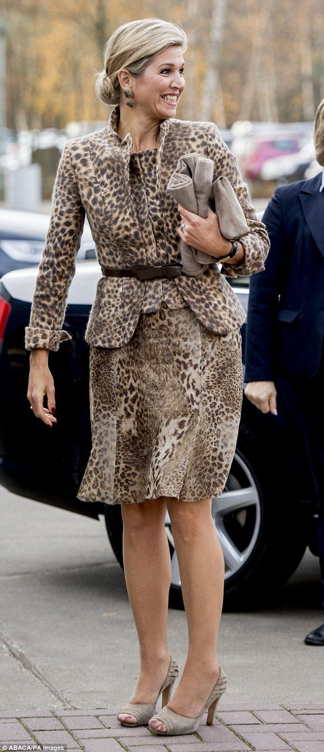 Queen Maxima beamed as she arrived, brightening up a dreary day in a leopard print suit...
