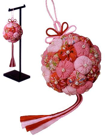 Japanese Blessed Ball Kit - Pink Instructions in JAPANESE ONLY.  You can purchase this with or without a hanger.  Usually ships in 1-3 weeks.  This kit includes Chirimen fabrics, cords, beads, and instructions in Japanese.  Finish size: W: 3.7in(9.5cm), H: 12.6in(32cm)  The actual fabrics may vary from picture. Ref # TG-3251  Description	Unit	Price	Qty. Japanese Blessed Ball Kit - Pink WITH Hanger 	set 	$55.95 	 Japanese Blessed Ball Kit - Pink WITHOUT Hanger 	ea 	$26.95