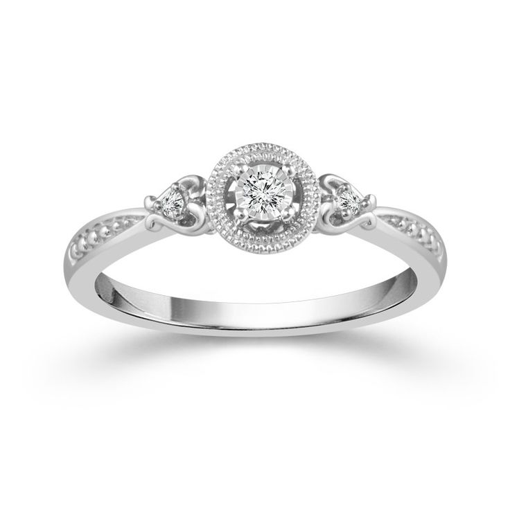 Sterling Silver .06cttw Round Diamond Halo Promise Ring. This classic promise ring features three round diamonds totaling .06cttw accented by a round halo.