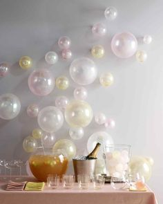Glitter Balloons | Martha Stewart Living - Who doesn't love a little glitz and glamour? Put a little sparkle in your party with glitter-infused balloons that you can blow up to different sizes and attach to the wall to create a glitzy backdrop to your bash.