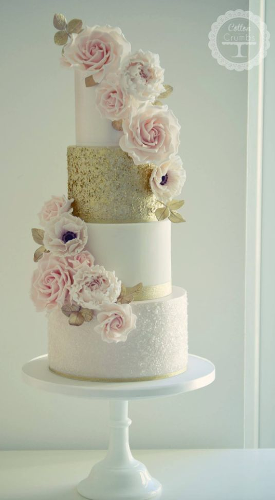 Glamorous white and gold wedding cake topped with pink flowers; Featured Cake: Cotton and Crumbs