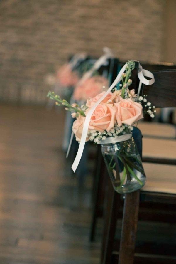 Love these mason jars for the aisle! Photo: Laura Elaine Photography