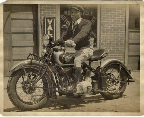 Men posing on motorcycles