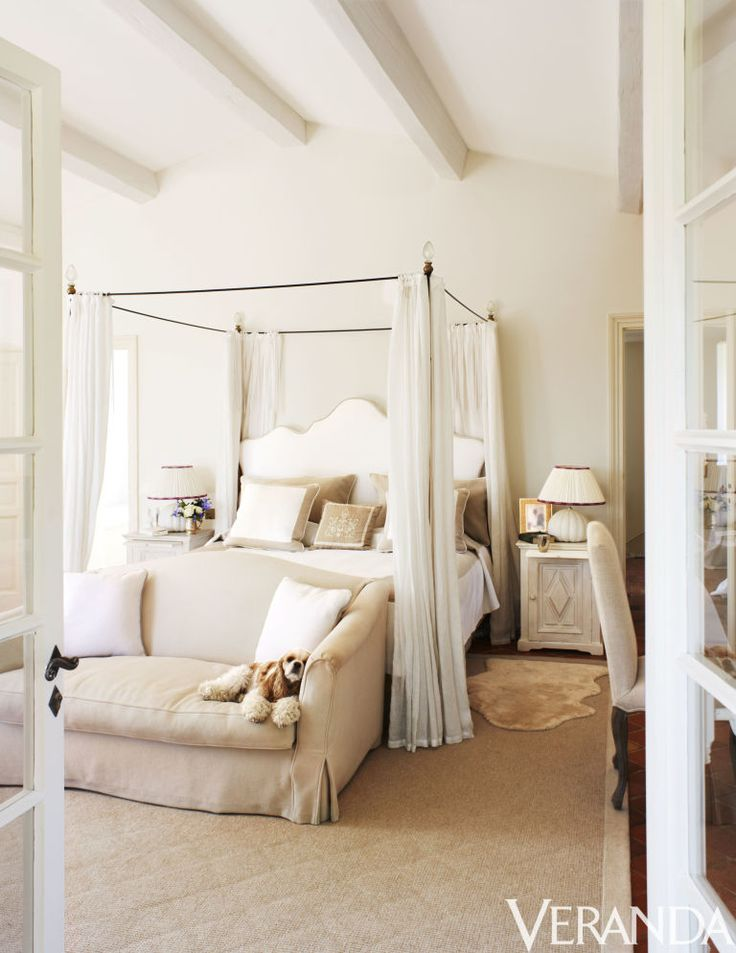 """White and neutral colors and a romantic canopy bed make for an ethereal guest room in this home this home in Saint-Tropez, France. Click for more from this excerpt from """"Veranda Retreats."""""""