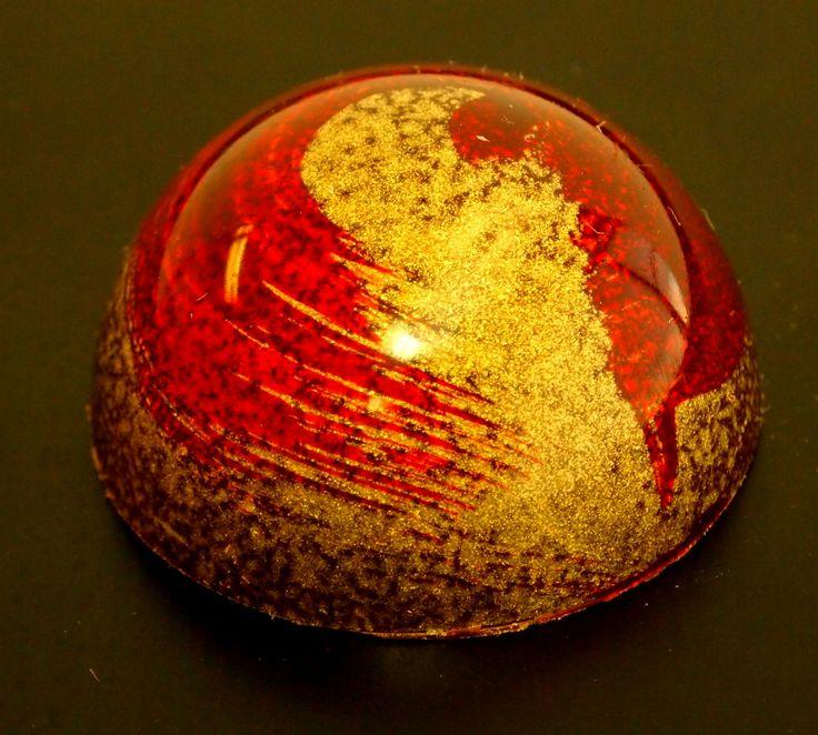 Sweet Chalet's Aurora chocolate bonbon cherry confit with balsamic vinegar flavor