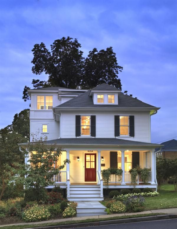 A 1910 four square got new life when a three-story tower addition was added to its left side.