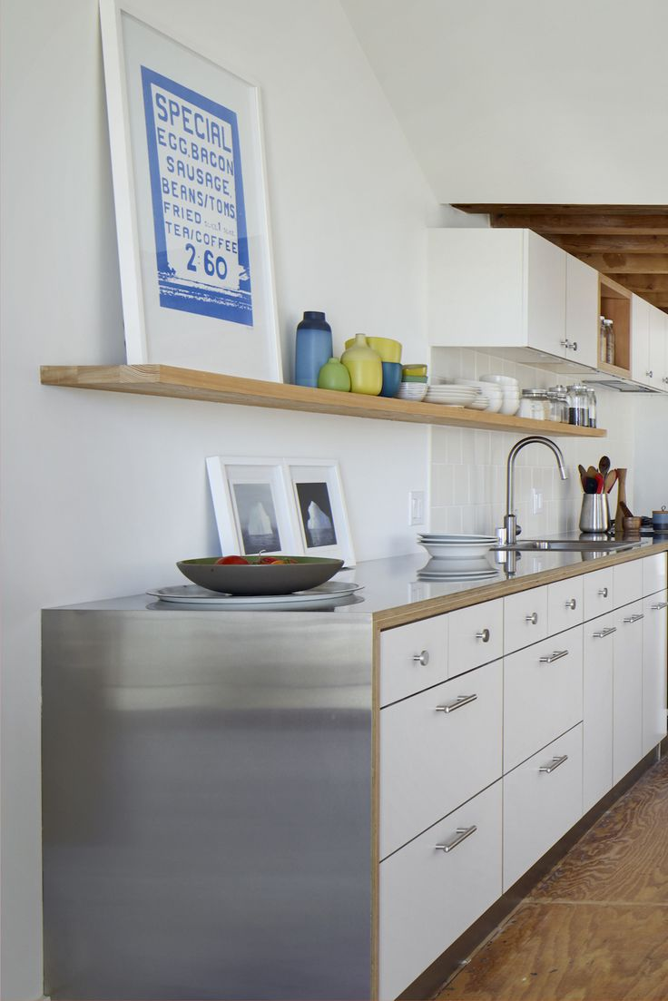 "LA architect Oonagh Ryan puts her own twist on stainless: ""Our favorite budget countertop is a sheet of brushed stainless steel with an exposed, clear-sealed multi-ply plywood edge. We often integrate the sink into the countertop, too, for a seamless look."""