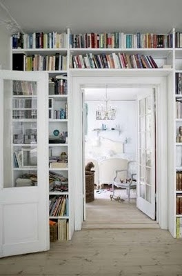 Bookshelves built in over doorway.