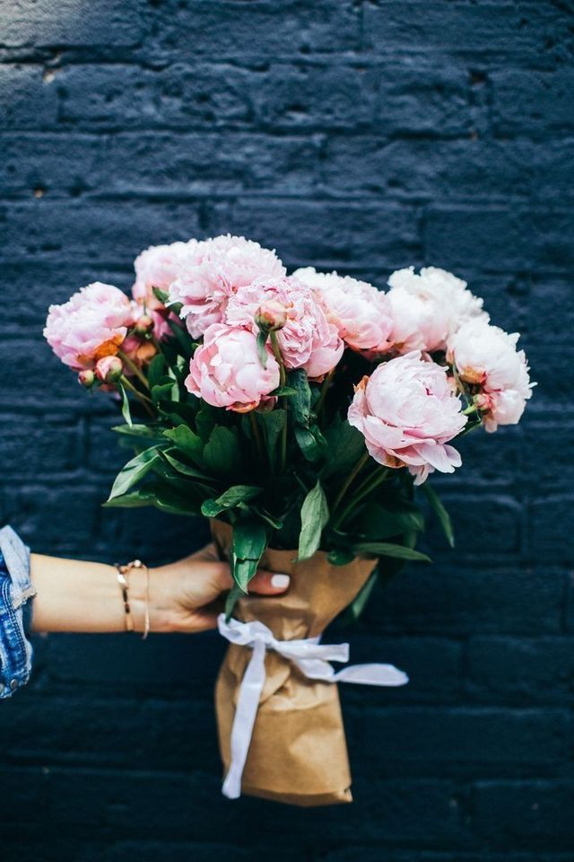 This is such a lovely bouquet of flowers. The light pink is so subtle and pretty. We love it against the navy background!