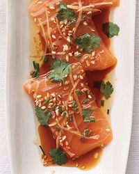 Salmon Sashimi with Ginger and Hot Sesame Oil - with citrus-soy dressing. The heat from the oil cooks the salmon just slightly, creating a luxurious texture and fragrance.