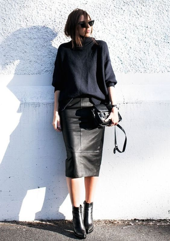 Minimal trends | Black oversized sweater with leather midi skirt, ankle boots and a handbag
