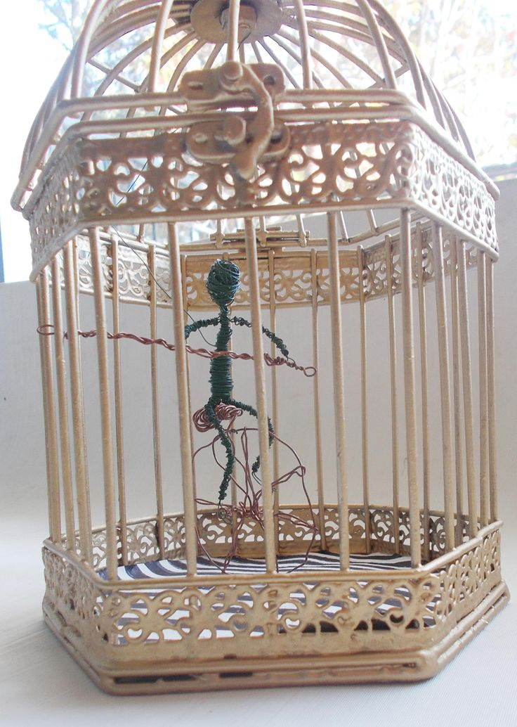 golden cage with handmade wire figurine balancer on a one wheel bicycle by mademeathens #wireworks