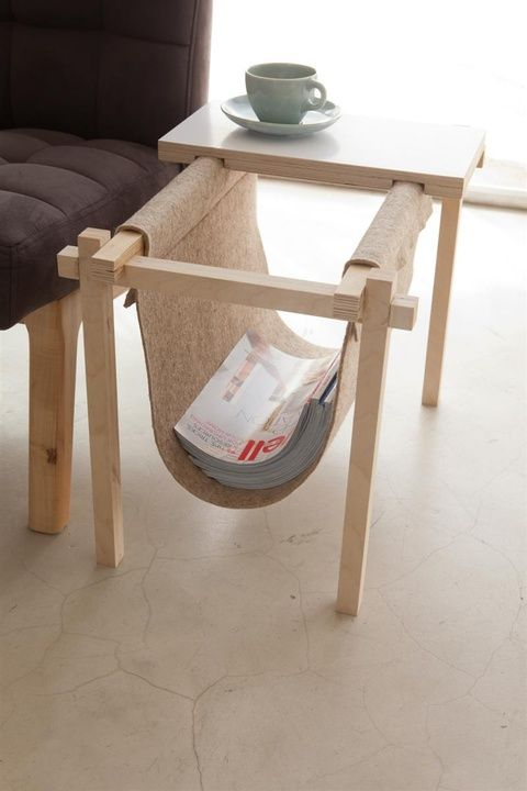 """This simple and practical magazine rack by designer Chuck Routhier not only stores your latest issues of Dwell but holds your coffee, too! Built from 1"""" square Baltic birch plywood and sporting a 100% wool eco-felt sling, the rack comes complete with a removable laminated birch-ply tabletop."""