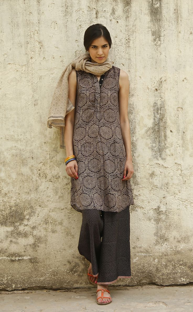 SIYAHI is the natural dye made from iron & molasses, a centuries-old technique practiced by the Khatri community in Bhuj. Our patterns were inspired by Godana tribal ink body decoration. Our artisan collaboration was playful and experimental, resulting in a collection of basic silhouettes with fluid, graphic patterns using siyahi, indigo and madder. See more on our Pinterest Board: SIYAHI . #SustainableLuxury #Apparels #SustainableFashion