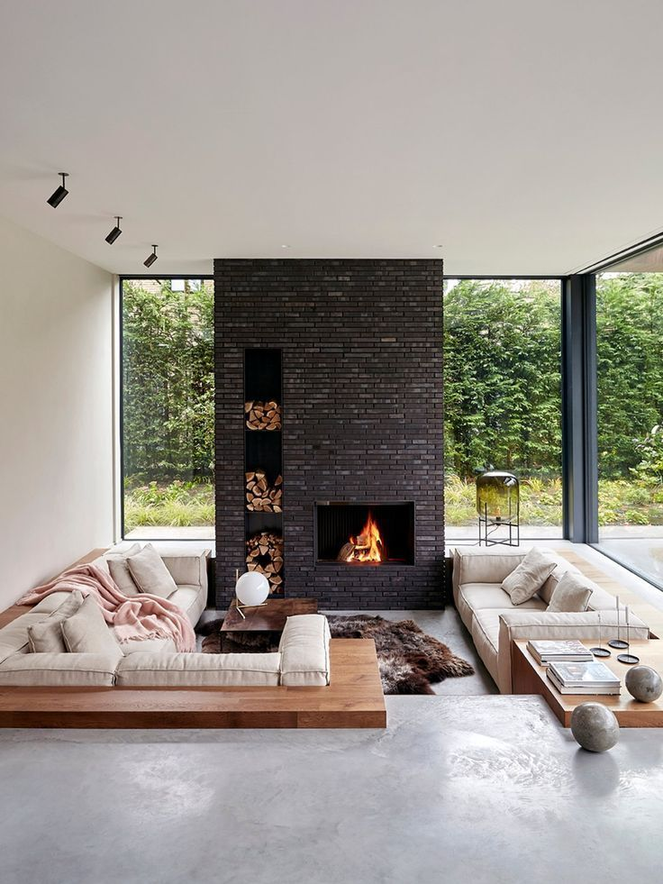 Sunken Fire Pit Living Room With Floor To Ceiling Dark Brick Fireplace Sunken Living Room Living Room Decor Colors Built In Couch