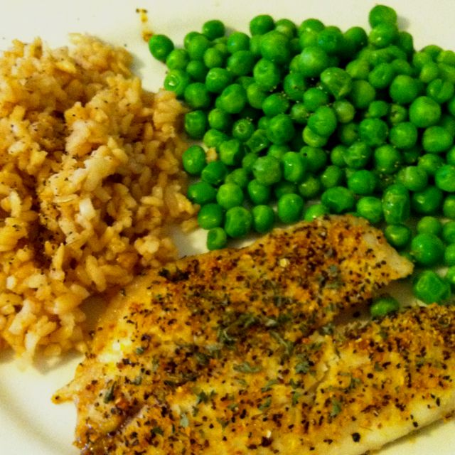 Tilapia filet with lemon pepper seasoning, steam fresh peas, and Uncle Ben's brown ready rice packet...healthy college meal on a budget :) Made by me!