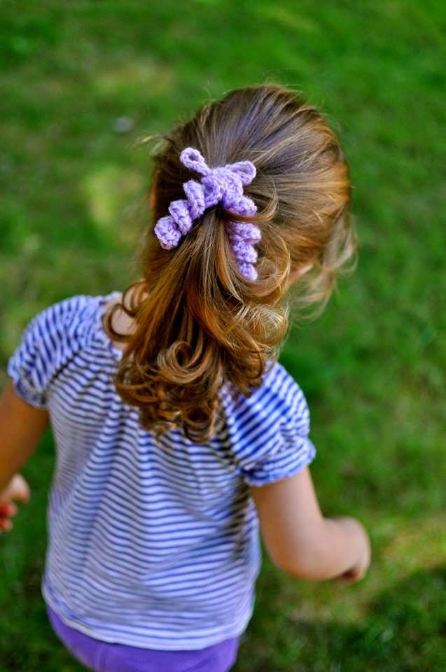 Do you remember your pigtails being tied with these fun Bouncy Hair Ties? This sweet and retro free crochet pattern is sure to please all the little girls in your life.  The crochet hair ties work up insanely fast, so you can make them in all the col
