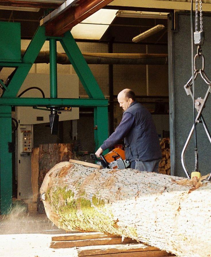 New 'green' oak log arriving into a Courvoisier cognac  mill
