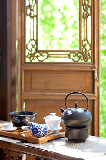 In the gardens of the First House of Merchants, there is a summer house overlooking the large carp pond.     (Lan Su Chinese Gardens tea house)