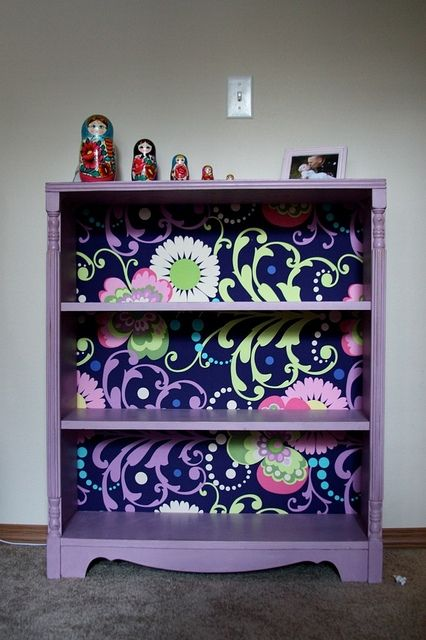 Refinished bookcase w/ fabric on the back. Love it.--I am doing this to my bookcase :) and putting it in the kids room