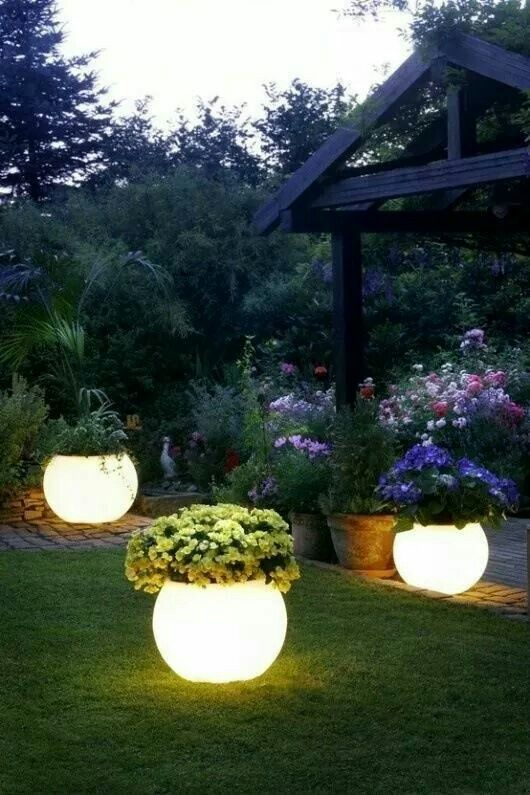 Rustoleum glow painted pots. Absorbs the sun during the day & glows at nite!