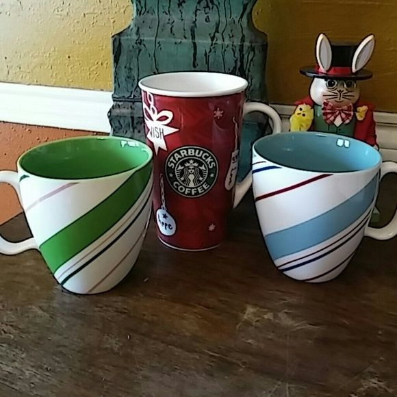 Starbucks Christmas Mugs Perfect to add to any Starbucks collection. 2 striped mugs and one large red mug. All Christmas cups. Used condition as pictured. Starbucks Accessories