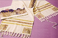 The tallit (also spelled tallis or talith) is a garment one can wear to create a sense of personal space during prayer - the name comes from two Hebrew words: TAL meaning tent and ITH meaning little.  By wrapping yourself in it, or by covering your head with it, the intention and direction of your prayers can be enhanced. The tradition is that the tallit is worn only during the morning prayers, except for the Kol Nidre service during Yom Kippur.