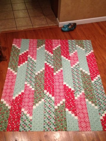 """Great Christmas quilt...Terry Atkinson pattern """"Fire Escape""""  Think of the small white squares as snowflakes."""