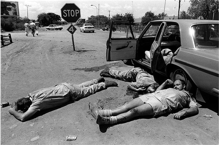 https://flic.kr/p/9LrVv9 | Journalists run from the scene of the execution of right-wing AWB members by a police in Bophuthatswana, South Africa, 1994, by Greg Marinovich (Kevin Carter took a shot of one of the victims begging for his life)
