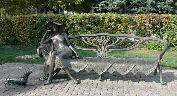 'Ramenskaya stranger'. Beautiful, a bored young woman alone sitting on the bench - quite proliferation urban sculpture.