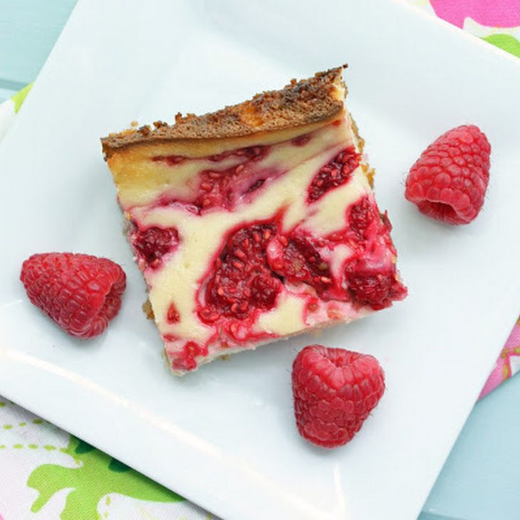Low Carb Raspberry Cheesecake Bars Recipe Desserts with butter, sugar substitute, coconut, coconut flour, baking powder, cream cheese, sugar substitute, vanilla extract, eggs, raspberries, sugar substitute