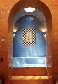 Casa Heyne tile bathtub. CASA HEYNE is a colonial hacienda style home built in 2000 of adobe in the Lavanderia area of San Miguel. Local workmen, woodworkers, stonemasons, iron workers and decorative painters handcrafted this 18,000 sq. foot plus home. Set on a hillside on the edge of the Historical district on a rock wall amid bougainvilleas and extensive gardens, it is only a 12-minute walk to the Jardin.