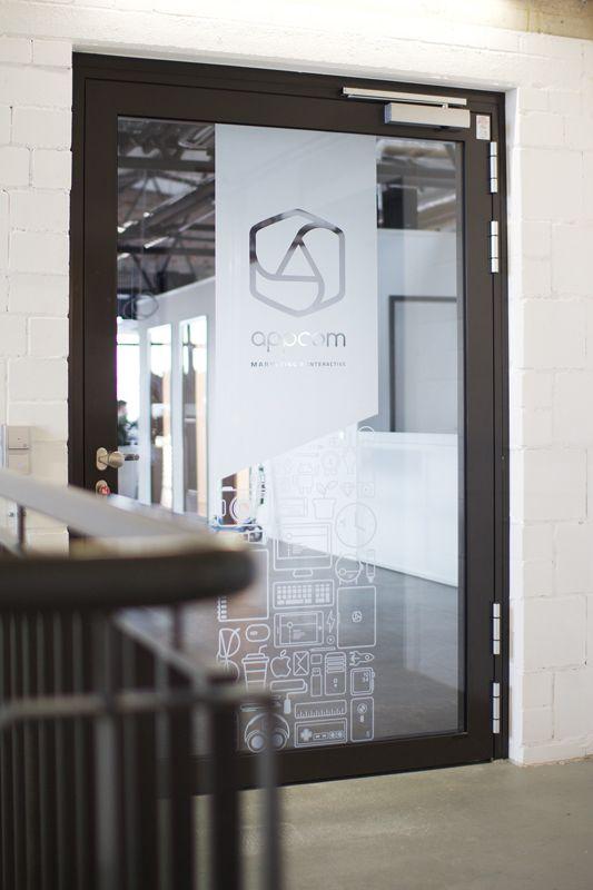appcom marketing & interactive   glass door decals   office interior design concept