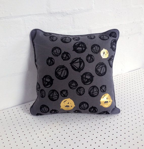 Hand printed cushion cover in grey 100% linen, screen printed by hand with black and gold abstract design