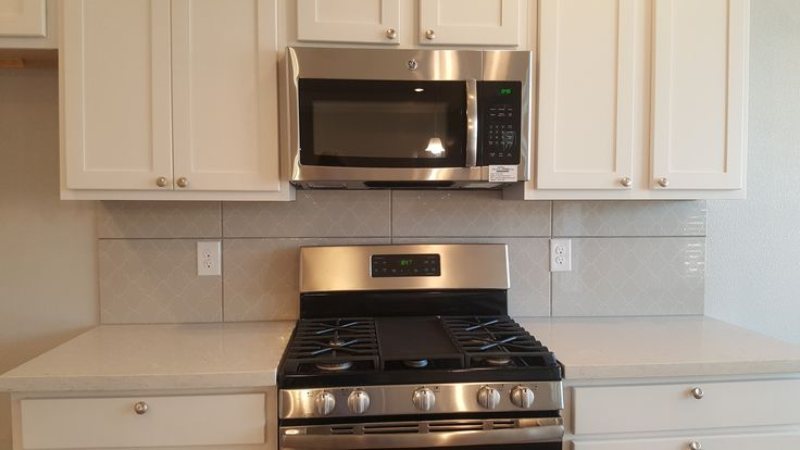 Stainless GE OTR microwave and gas range