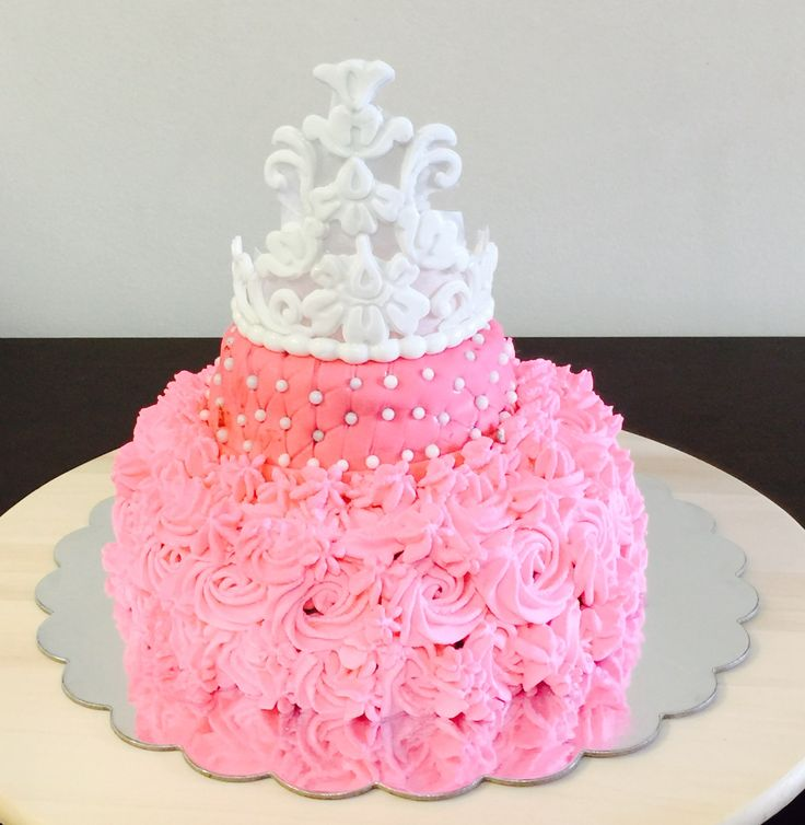 My first princess tiara cake I crafted tiara and cake is loaded with chocolate and strawberry fillings Decorated with barbie pink rosette