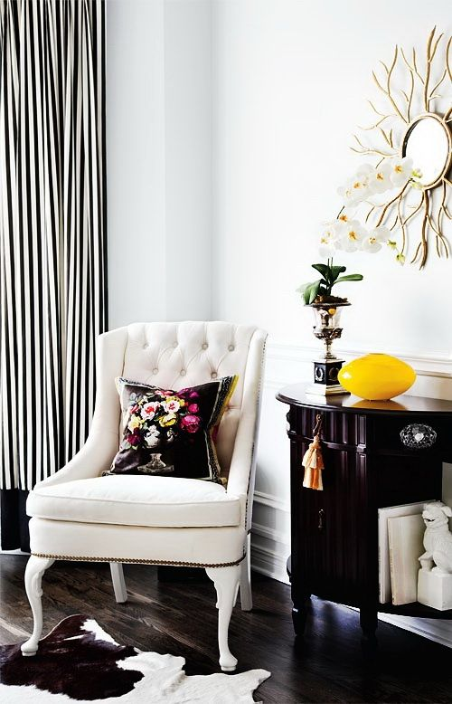 A Clean Black And White Decor Keeps The Palette Clean; The Mirror Adds A Bit